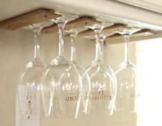 """T-moulding"" is perfect for making wine glass holders under cabinets."