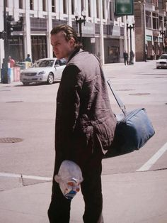 Amazing shot of Heath without Joker makeup. I love the opening scene of TDK.