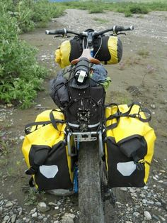 Bicycle touring panniers, fully loaded for the ride.