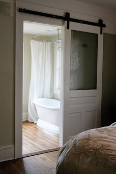 Space saving sliding door to bathroom. This is what we will do in the master room. This is the kind I want, but slide to the left