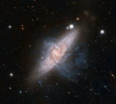 Aligned Galaxies NGC 3314, overlapped, but tens of millions of light-years apart.