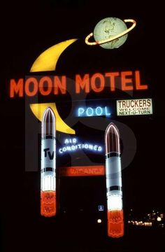 Moon Motel sign lit up at night.    Retropedia - A look at style and design through time