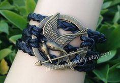 mockingJay pin bracelet,creative bracelets,games bracelet,leather bracelet, black braid,hunger bird bracelet,favorite gifts on Wanelo
