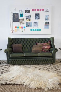 Our take on Capricorn Zodiac Style using our deep green leather Osborne Sofa paired with a few neutral rugs. | Patina