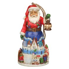 4042971 Santa With Train Hanging Ornament- This whimsical Santa with train is sure to deliver a smile. Beautifully handcrafted in incredible detail, this jolly Santa is richly decorated with a Christmas Eve cityscape encircled by a fanciful locomotive steaming straight from the North Pole #christmas #enesco #jimshore