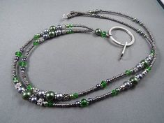 Items similar to Beaded breakaway lanyard for ID badges green and gray glass pearls and crystals to badge holder with magnetic or toggle clasp on Etsy Pearl Beads, Crystal Beads, Crystals, Beaded Jewelry, Beaded Necklace, Beaded Bracelets, Pearl Bracelet, Grey Glass, Purple Glass