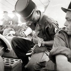 http://www.reddit.com/r/pics/comments/2v2kw2/a_french_soldier_feeding_his_cat_in_indochina_1956/