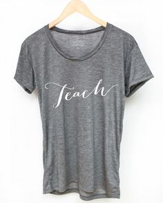 We love our teachers and they will love this perfect relaxed soft tee with  our white 'Teach' design!  The shirt fits true to size.  50% polyester and 50% rayon