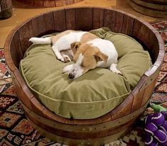 You know those half wine barrel planters you can get from Lowe's or Home Depot this time of year? With the help of a jigsaw, some sand paper, a little stain and some polyurethane (if you like).....you could make this dog bed in 2 hours or less. (Thank you Maverick Homestead (FB) for this adorable image!)