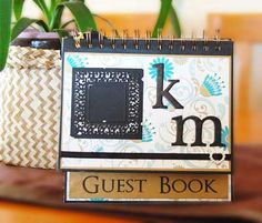 Guest book idea. Stands up on a disalpy with a frame for a photo on the front, and inside are polaroids for the guests, with signed well wishes. (A polaroid camera at the sign-in?)