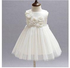 Niña blanca de bautizo vestido blanco perla dedicación