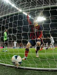 Lionel Messi of Barcelona celebrates scoring his goal during the La Liga match between Real Madrid CF and FC Barcelona at the Bernabeu on March 23, 2014 in Madrid, Spain.