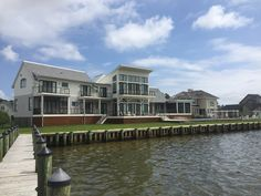 AAP's Bronze Cable Rail + Screen System Screen Porch Systems, Cable Railing Systems, Stainless Steel Cable Railing, Porch Enclosures, Rehoboth Beach, Property Values, Waterfront Homes, Curb Appeal, Aluminum Products