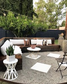 This is our seating area fully completed. It's the perfect backyard getaway, and I was able to incorporate the same boho style I love with some added decor. We built this project in 10 days as a family. It was worth every long hard day we put into it. Outdoor Seating Areas, Outdoor Spaces, Outdoor Living, Outdoor Decor, Seating Area In Garden, Outdoor Patios, Outdoor Gardens, Container Design, Garden Furniture