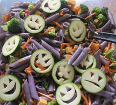 Halloween Pasta Salad. Ingredients includes pasta carrots broccoli cheddar cheese and zucchini cut with spooky faces. Cherry tomatoes cucumbers cauliflower and snow peas all work well too. Add food coloring to the pasta water or use squid ink pasta for a spooky color. Toss the whole mix with some Italian dressing and let it sit for an hour or two. Delish!