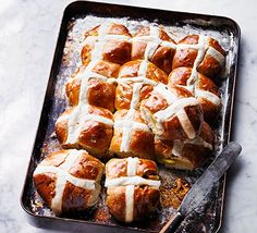 A zesty twist on an Easter favourite, serve with creamy lemon curd and watch these tasty hot cross buns disappear