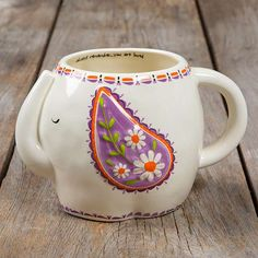 "Elephant Folk Art Mug - This folk art mug will have you smiling every time you drink from it! It features an adorable elephant design and the sweet sentiment, ""Always remember you are loved"" on the inside! This hand sculpted, ceramic mugs is microwave and dishwasher safe."