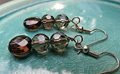Handcrafted Gray Smoky Quartz Pierced Earrings by SparkleCatStudio. 25% of our proceeds donated to animal rescues.  A lot of our pieces never make it to Etsy because they are sold first or are custom pieces, so be sure to look for us on Facebook.  Find us on Facebook here. https://www.facebook.com/SparkleCatStudio