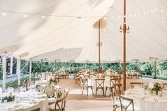 Summer boho outdoor wedding inspiration- outdoor tent with bistro lights, rustic wooden cross-back chairs, blush and white floral arrangements with greenery. Willowdale Estate is a weddings and events venue in New England. Willowdaleestate.com | Lena Mirisola Photography
