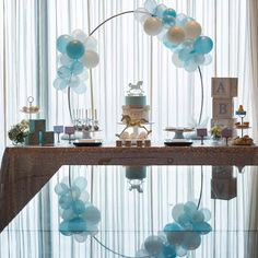 Beautiful and simple styling by @kisswithstyle for a baby shower featuring our mini arch Perfect photography by @otisandsunday
