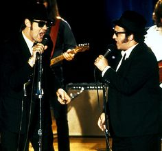 The Blues Brothers (1980)  Director: John Landis  The best in rhythm and blues meets the best in spectacular car-crash action meets the best in cult sunglass-wearing characters.