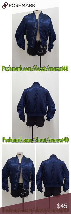 "Rex Bomber Rex Bomber  A satiny bomber jacket with a solid-color. Slanted pockets. Blue ribbed-knit trim. Full front zipper closure.  * Measures approx. 21"" length, 36"" chest, 32"" waist, 23"" sleeve length * 100% polyester * Model is in size S * Model is 5'10.5"", 34"" bust, 24"" waist, 34""  * Color : Navy Tea n Cup Jackets & Coats"