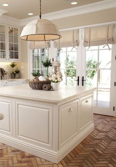 Love the color of white in this kitchen and the roman shades!!! And herringbone floor which needs to have little pattern anywhere else. Probably pick up some brown up above, but not too much. love this creamy white!!!
