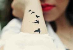 Bird Tattoo. Black. Arm.