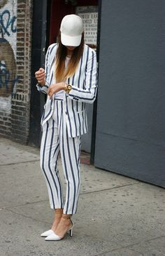 the stripped suit; love these white pumps with the clear ankle strap