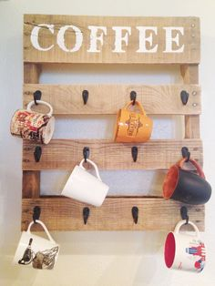 22 Easy DIY Reclaimed Wood Projects for Your Home, DIY and Crafts, Craft this cute coffee mug organizer that will add an artistic piece to your kitchen wall. Use paint and a sponge for the stenciled top.