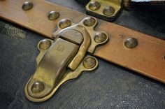 lock on an old louis vuitton travel trunk on display in cairns store