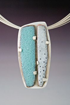 play with torch-fired enamel, then set over solid sheet of silver or ...  Teal and white silver pendant