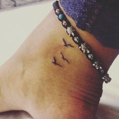 Birds in flight on ankle
