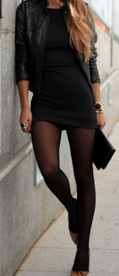 Chestlength sandy blonde hair, LBD with a leather jacket & matching clutch, hose, caramel pumps