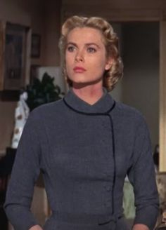 Grace Kelly in 'Dial 'M' for Murder', 1954 - Directed by Alfred Hitchcock. Costume designer Moss Mabry showcased the elegance of the 1950s fashion & designs. As the film came to it's close, he dressed Grace Kelly in more subdued colors, like this simple, charcoal grey dress.