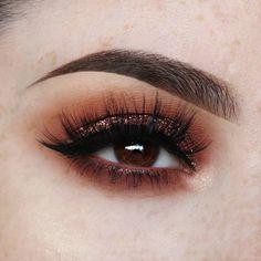 Burgundy eye look with glitter