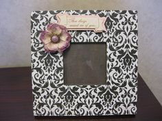 Picture frame made with scrapbook paper & accessories