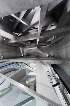 Cavernous Budapest metro stations feature concrete lattice overhead.