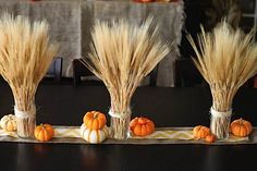 Beginners Level - Easy Peasy! - About 5 mins to create if you have supplies - Fall Table Decoration - Wrap twine, burlap, fav ribbon or other fabrics around a semi tall glass. Make sure to use a glass tall enough so it wont fall over. Cut faux wheat to height wanted, place into glass. Add other fall decorations to table. Visit site to see other table decorations.