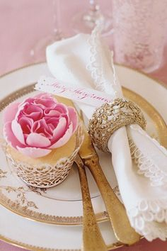 Gold flat wear and pink rose cupcake. lace details are the perfect accent for an ultra-romantic reception theme with a vintage twist Wedding Table Place Settings, Beautiful Table Settings, Wedding Reception Decorations, Wedding Themes, Wedding Ideas, Reception Table, Vintage Wedding Theme, Gold Wedding, Napkin Rings