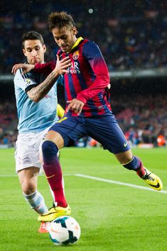 Neymar Santos Jr (C) of FC Barcelona and Hugo Mallo of RC Celta de Vigo fight for the ball during the La Liga match between FC Barcelona and RC Celta de Vigo at Camp Nou on March 26, 2014 in Barcelona, Catalonia.