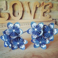 www.flairforfleur.co.uk paper bouquets roses and origami kusudama hand pressed paper lace blue and whites flower girl wands