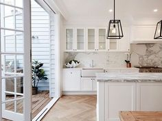 doors opening to terrace/porch/sunroom white cabinets - herringbone floor - move sink to island Home Interior, Kitchen Interior, Interior Doors, Interior Design, Modern Interior, Küchen Design, House Design, Cuisines Design, Beautiful Kitchens