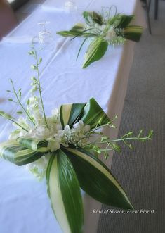 Centerpiece: Aspidistra 'bow' and Dendrobium Orchids Contemporary Flower Arrangements, Large Flower Arrangements, Home Flowers, Church Flowers, Orchid Flowers, Summer Flowers, Deco Floral, Arte Floral, Orchid Centerpieces
