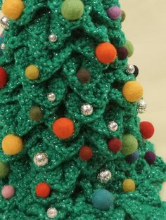 Dragon-Stitch (Scale stitch, Crocodile stitch) Tree.  I am imagining doing a garland of sorts in a very chunky yarn and stringing it across a triangle-shaped frame to make a tree. Then hanging ornaments from the garland.