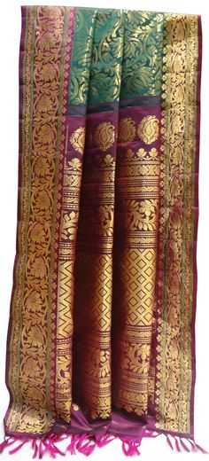 This pure #gadhwalsilk  saree with beautiful golden zari work on the time-tested color combo of green and maroon is a must have attire this Eid!   Comes at just Rs.12700/-.Gadhwals are the handloom #traditionalsarees of Andhra/Telangana District and they look gorgeous when worn on   occasions like weddings/festivals. This saree has all over work however they come in various design patterns like booties all over,checks,body plane and so on...