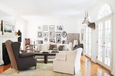 The+Family+Scrapbook+Gallery+Wall:+In+this+LA+home,+family+photos+printed+in+black-and-white+lends+an+authentic+and+personal+touch+that+compliments+the+neutral+color+palette.