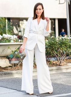 85cc5dd7ff White fuzzy jacket and black jumpsuit.