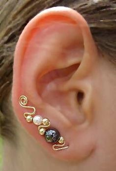 Ear sweep...uses 1 piercing. Link takes you to buy them but pretty easy to make