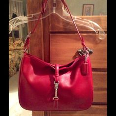 """Gorgeous Coach Bag Like new and so pretty!  There is. One dot on it that's not noticeable, unless your looking for it. The lining is like new. It measures 9"""" high by 11 & 1/4"""" and about 3"""" wide. Coach Bags"""